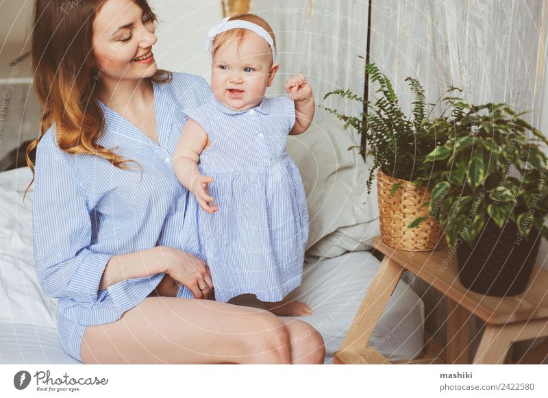 happy mother and 9 month old baby playing in bedroom Lifestyle Joy Playing Bedroom Baby Parents Adults Mother Family & Relations Infancy Hand Stripe Love
