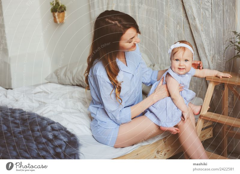 happy mother and 9 month old baby in matching pajamas Lifestyle Joy Happy Playing Bedroom Baby Parents Adults Mother Family & Relations Infancy Hand Stripe