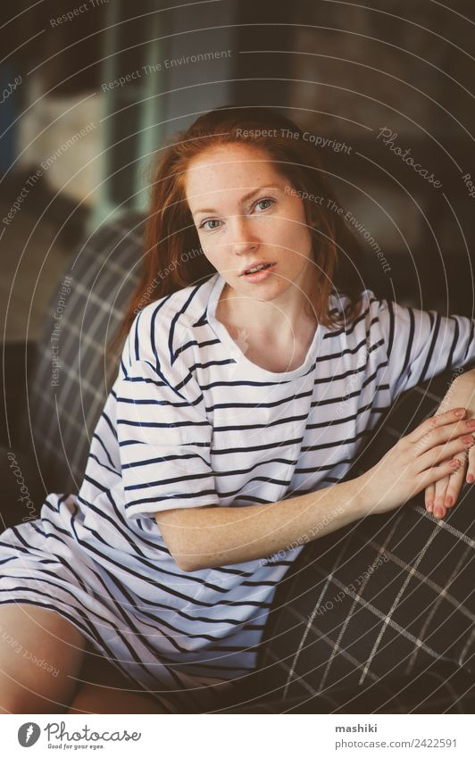 portrait of young beautiful redhead thoughtful woman Woman Youth (Young adults) Relaxation Dark Adults Lifestyle Sadness Feminine Gray Dream Modern Book Soft