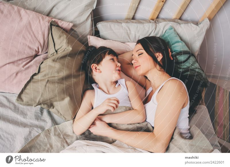 mother and child son sleeping together in bed Child Relaxation Joy Adults Lifestyle Love Emotions Family & Relations Boy (child) Together Smiling Sleep Soft
