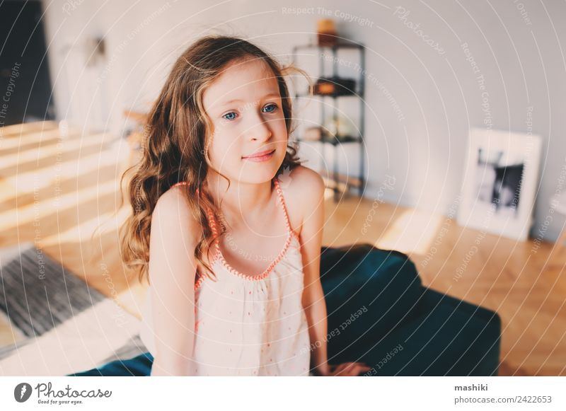 cute kid girl relaxing at home in cozy weekend morning Lifestyle Joy Happy Relaxation Leisure and hobbies Playing Flat (apartment) Child Infancy Smiling