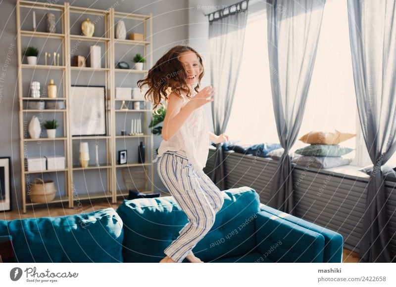 happy kid girl playing at home in weekend morning Lifestyle Joy Relaxation Playing Flat (apartment) Child Family & Relations Infancy Jump Crazy Comfortable Home