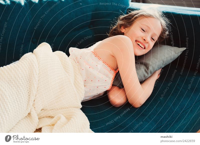 kid girl relaxing at home in weekend morning Lifestyle Joy Relaxation Playing Flat (apartment) Child Infancy Fatigue Comfortable Home young laziness lazy casual