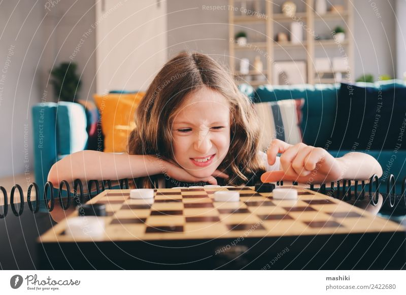 lifestyle shot of smart kid girl playing checkers at home Lifestyle Leisure and hobbies Playing Chess Success Child Girl Family & Relations Infancy Toys Think