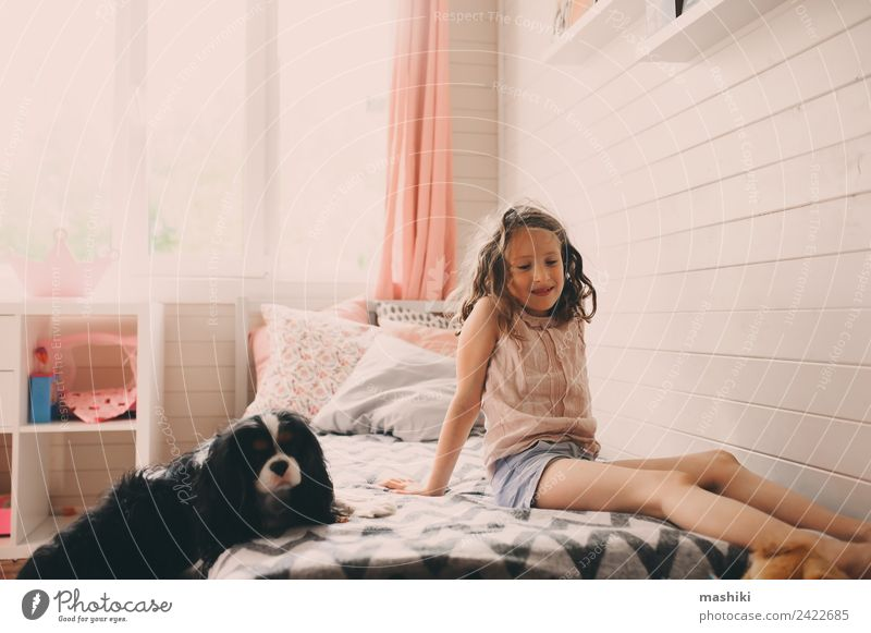 kid girl playing with dog in her room Lifestyle Playing Bedroom Child Toys Authentic Modern Clean Safety (feeling of) Creativity realistic imperfection