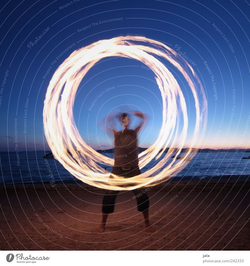 Human being Sky Man Ocean Beach Joy Adults Landscape Playing Sand Leisure and hobbies Masculine Esthetic Fire Circle Shows