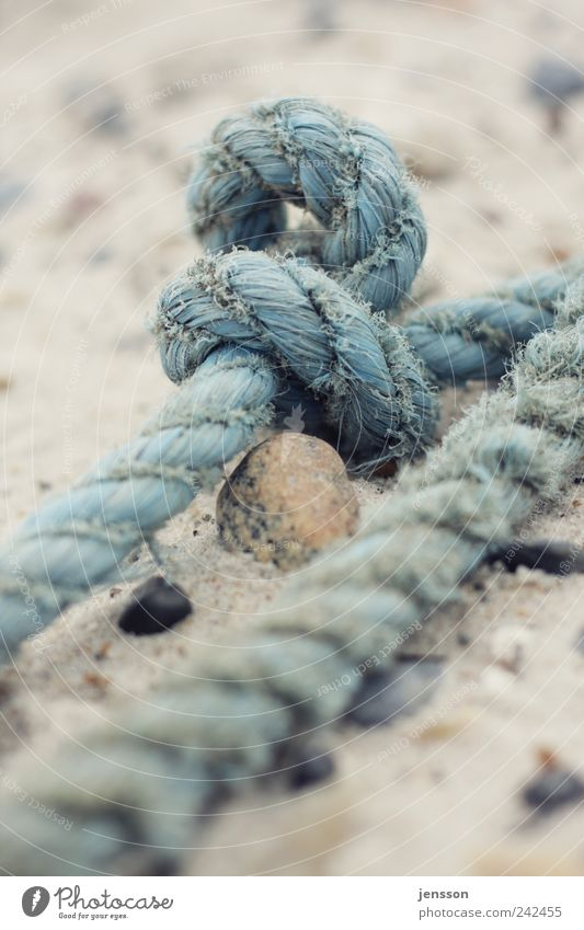 sailor's yarn Environment Nature Sand Beach Knot Old Dirty Blue Rope Navigation Memory Remember Fishery Find Flotsam and jetsam Discovery Colour photo