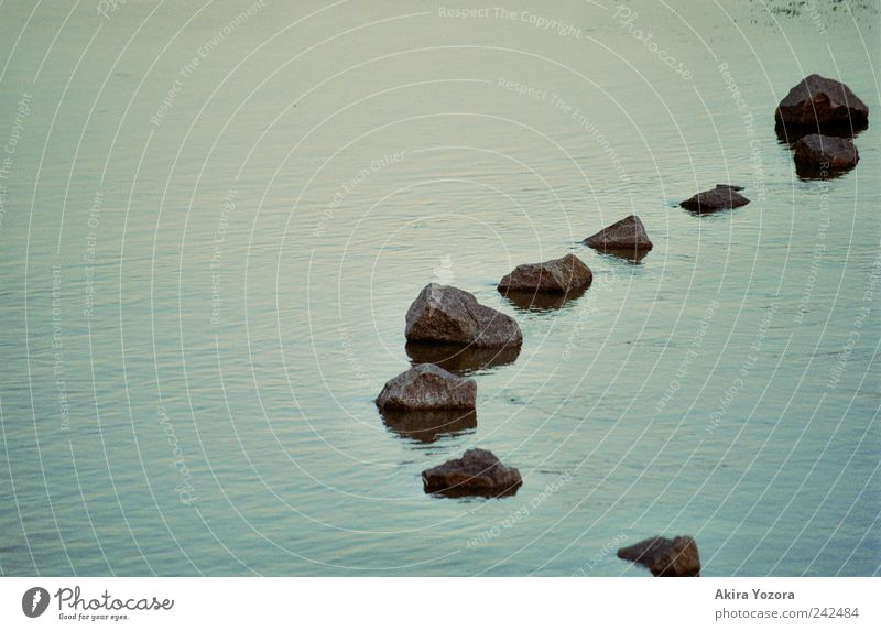 stone chain Water River bank Swimming & Bathing Cold Wet Blue Gray Black Stone Unwavering Colour photo Exterior shot Deserted Copy Space left Evening