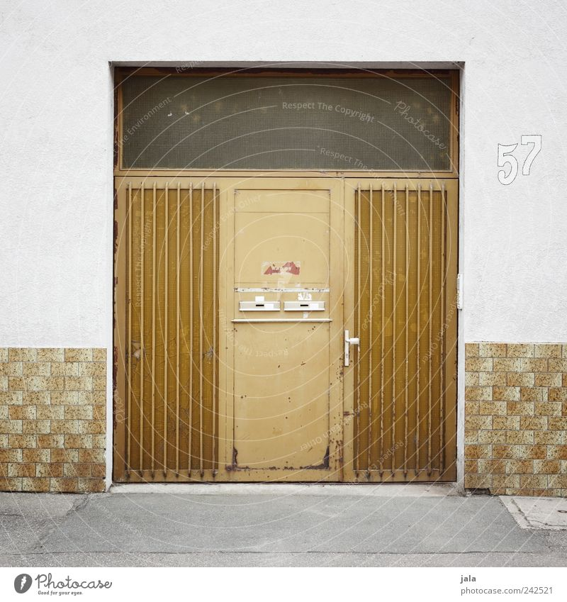 White Yellow Wall (building) Gray Lanes & trails Wall (barrier) Building Door Gold Facade Digits and numbers Manmade structures Entrance Mailbox Front door