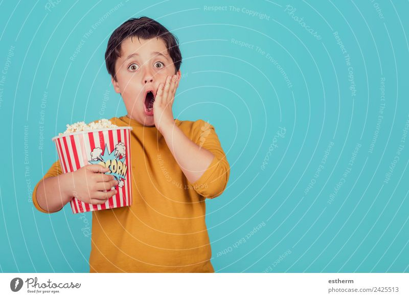 surprised boy with popcorn Child Human being Joy Eating Lifestyle Emotions Movement Boy (child) Food Leisure and hobbies Masculine Nutrition Infancy Smiling