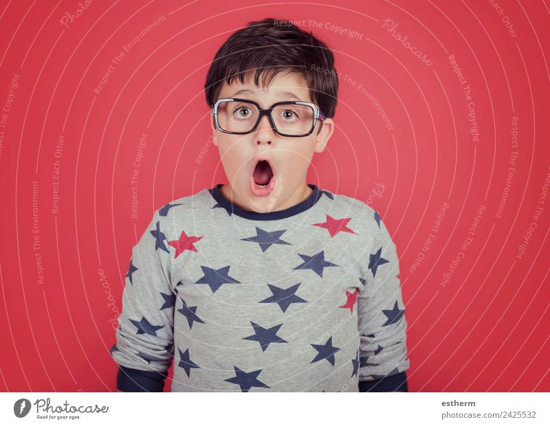 surprised boy with glasses Human being Masculine Child Toddler Boy (child) Infancy 1 8 - 13 years Eyeglasses Movement Think Fitness Smiling Cool (slang)