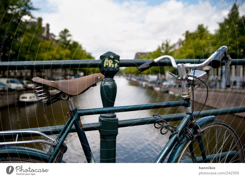 kind Bicycle Old town Bridge Passenger traffic Boating trip Motorboat Stand Wait Blue Green Black Silver Amsterdam hollandrad Bridge railing Bicycle saddle
