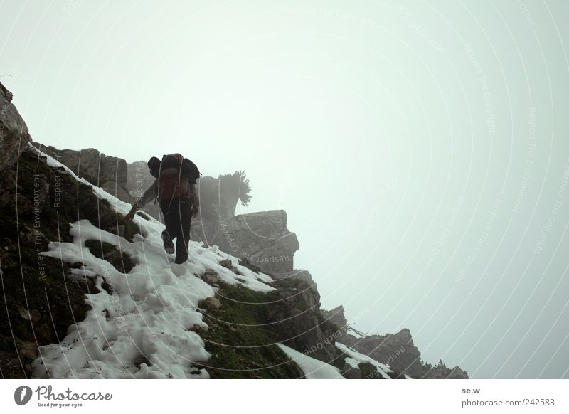 Human being Sky Vacation & Travel Calm Clouds Loneliness Dark Snow Autumn Mountain Freedom Gray Hiking Fog Rock Adventure