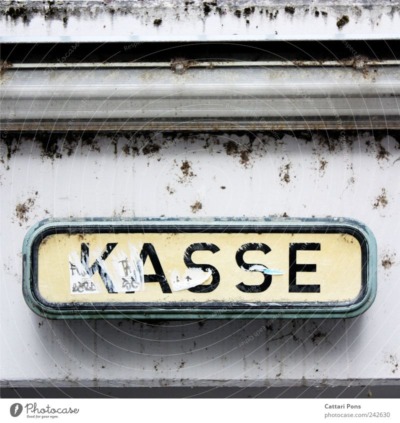K A S S E Places Hang Wall (building) Signs and labeling Cash register Clue Signage Paying Dirty Old Pay day Pallid Bright Colour photo Exterior shot Day