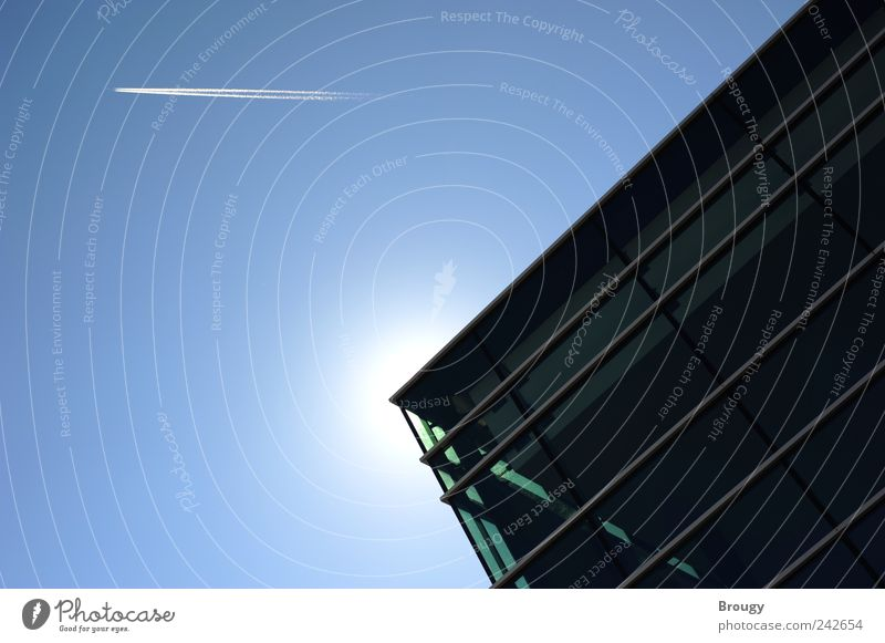 Corner of a modern building with sun and airplane Aviation Airplane Vapor trail Art Sky Cloudless sky Sun Sunlight Beautiful weather Friedrichshafen