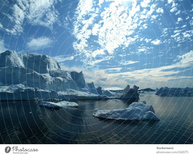 Ice Blue Stories Nature Landscape Elements Water Sky Climate Climate change Frost Ocean Iceberg Far-off places Greenland Clouds The Arctic North Pole