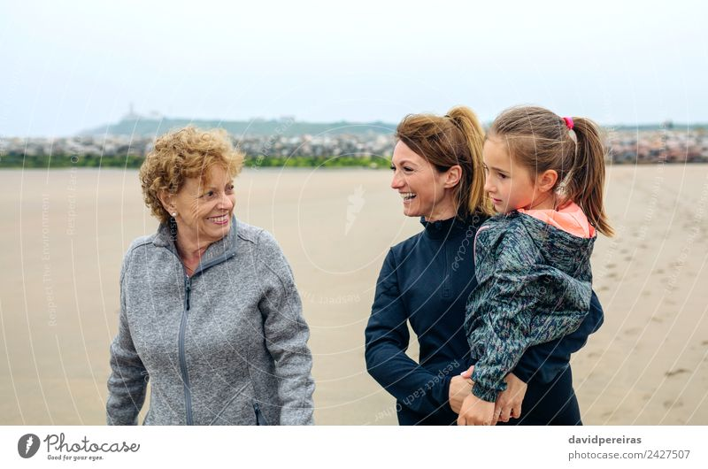 Three generations female walking on the beach Lifestyle Joy Happy Beautiful Beach Child Human being Woman Adults Mother Grandmother Family & Relations Sand Sky