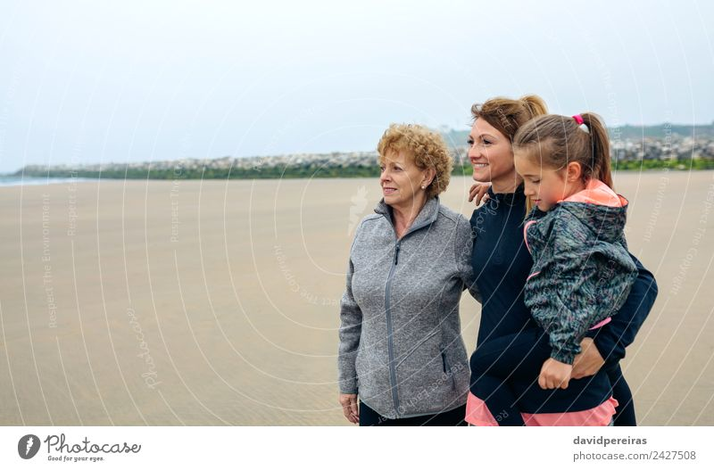 Three generations female looking at sea Woman Child Human being Beautiful Ocean Joy Beach Adults Lifestyle Autumn Love Family & Relations Happy Small Copy Space