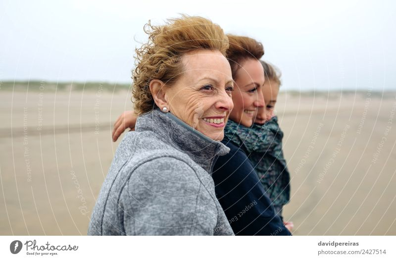 Three generations female walking on the beach Lifestyle Joy Happy Beautiful Beach Ocean Child Human being Woman Adults Mother Grandmother Family & Relations