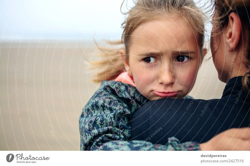 Angry girl hugging her mother on the beach Lifestyle Happy Beautiful Beach Ocean Child Human being Woman Adults Mother Family & Relations Sand Autumn Fog Love