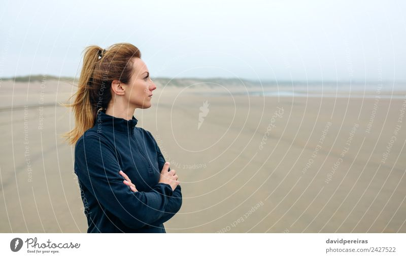 Woman looking at sea Lifestyle Beautiful Meditation Beach Ocean Human being Adults Sand Autumn Fog Think Sadness Authentic Loneliness Future worried walk Action