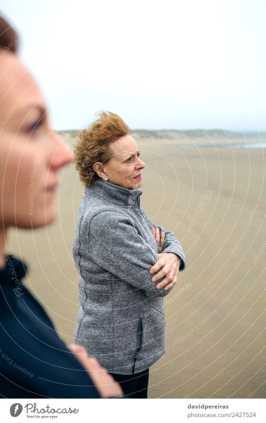 Two women looking at sea Woman Human being Beautiful Ocean Beach Adults Lifestyle Autumn Love Family & Relations Sand Fog Action Authentic Wind Mother