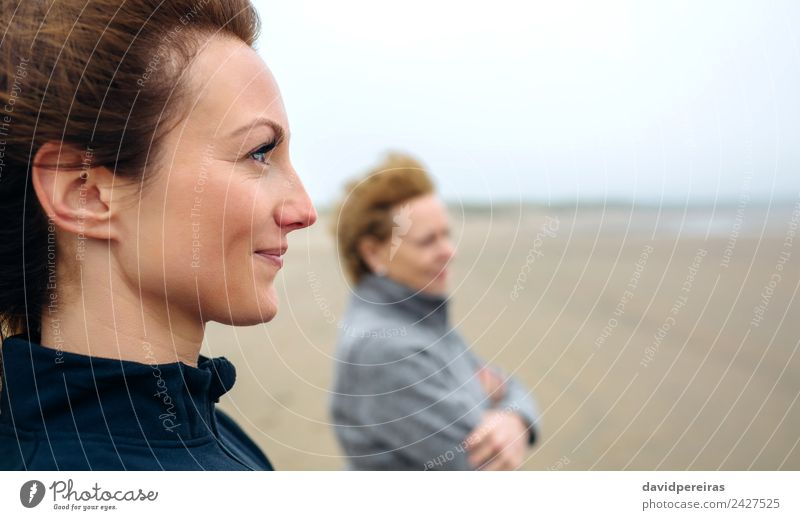 Women looking at sea on beach Lifestyle Joy Beautiful Meditation Beach Ocean Human being Woman Adults Mother Grandmother Family & Relations Sand Autumn Wind Fog