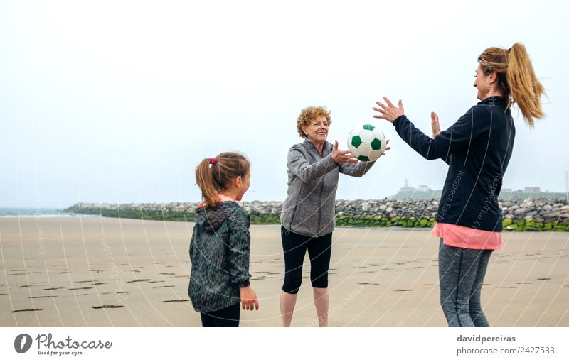 Three generations female playing on the beach Lifestyle Joy Happy Playing Beach Child Retirement Human being Woman Adults Mother Grandmother Family & Relations