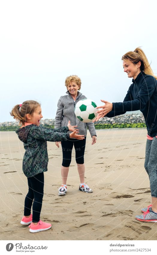 Three generations female playing on the beach Lifestyle Joy Happy Playing Beach Child Human being Woman Adults Mother Grandmother Family & Relations Sand Autumn