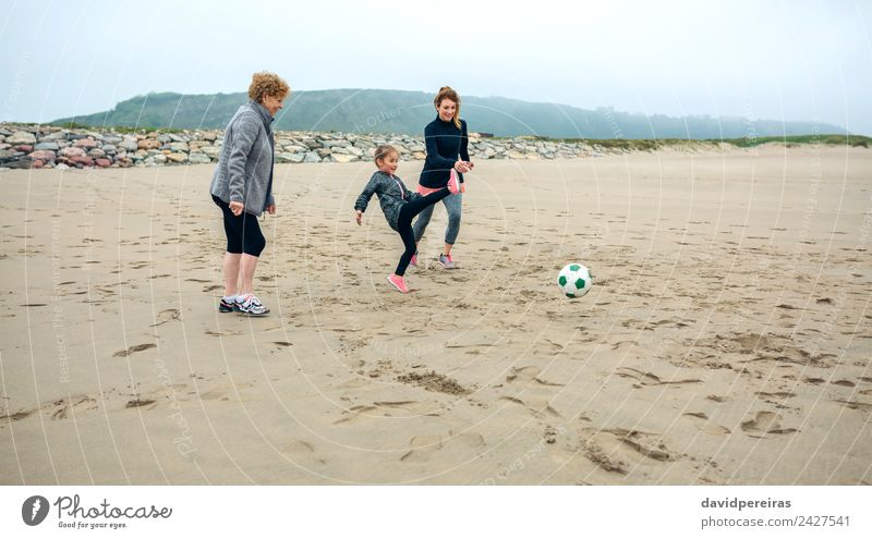 Three generations female playing soccer on the beach Lifestyle Joy Happy Playing Beach Child Human being Woman Adults Mother Grandmother Family & Relations Sand