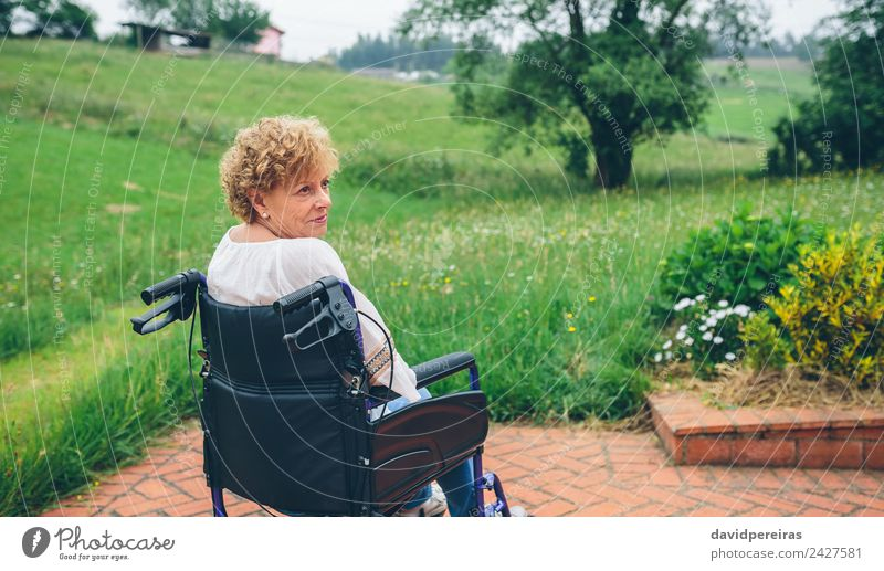 Senior woman in wheelchair Health care Relaxation Garden Retirement Human being Woman Adults Grandmother Nature Plant Tree Grass Old Sit Sadness Authentic