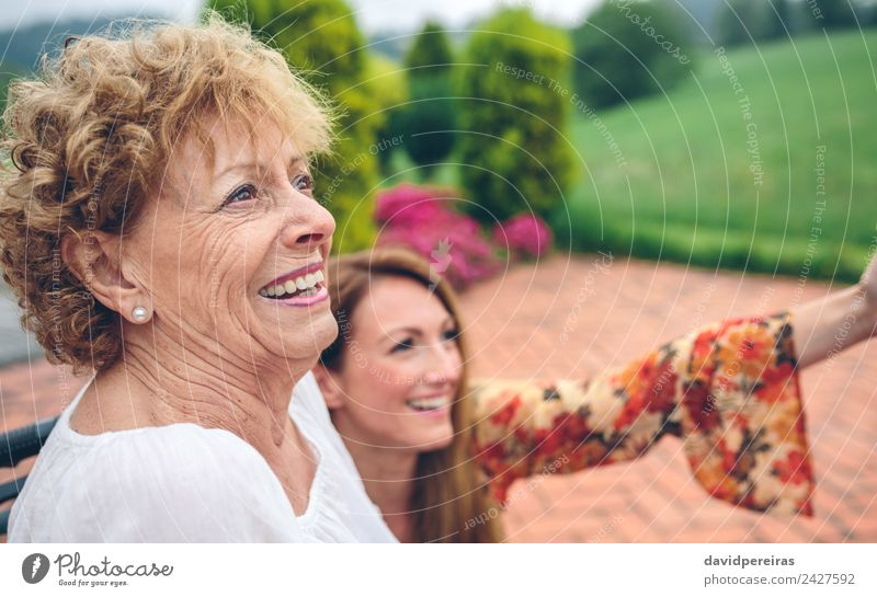 Senior woman in wheelchair laughing with her daughter Lifestyle Happy Health care Relaxation Garden Human being Woman Adults Mother Grandmother