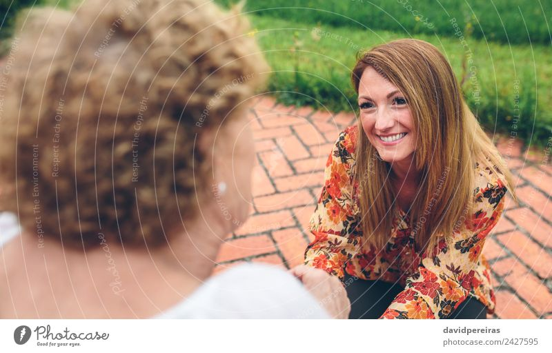 Young woman caring elderly woman in garden Lifestyle Happy Health care Relaxation Garden To talk Human being Woman Adults Mother Grandmother Family & Relations