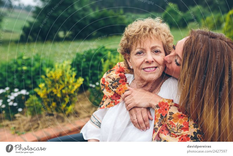 Senior woman in a wheelchair with her daughter Woman Human being Nature Old Plant Tree Adults Love Health care Family & Relations Happy Garden Copy Space