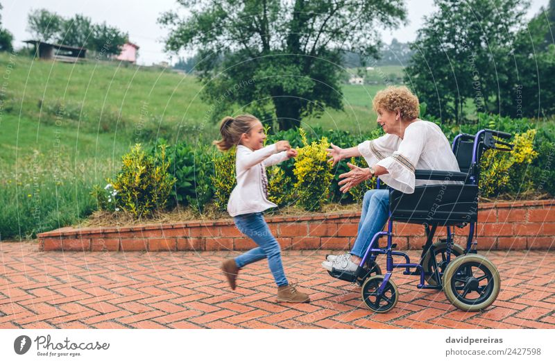 Granddaughter running to greet her grandmother Lifestyle Happy Health care Relaxation Garden Human being Woman Adults Grandmother Family & Relations Nature