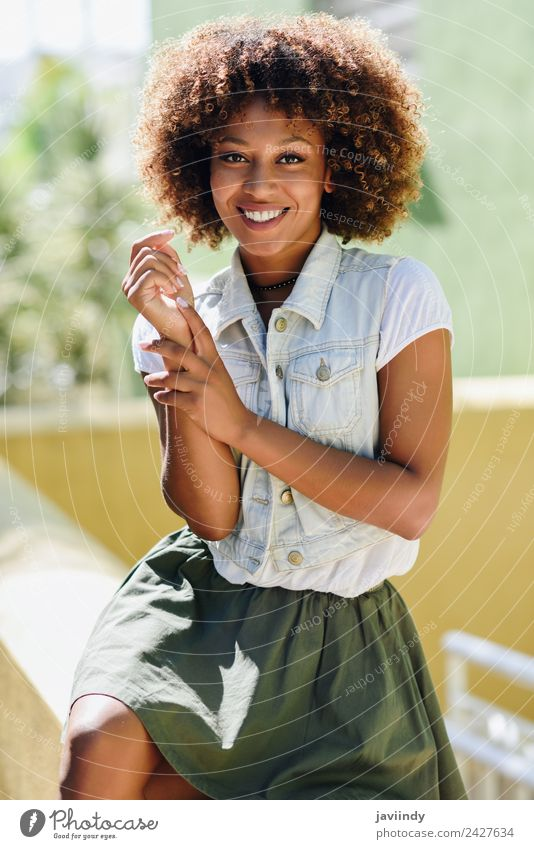 blYoung black woman, afro hairstyle, smiling outdoors Lifestyle Style Happy Beautiful Hair and hairstyles Face Human being Woman Adults Street Fashion Brunette