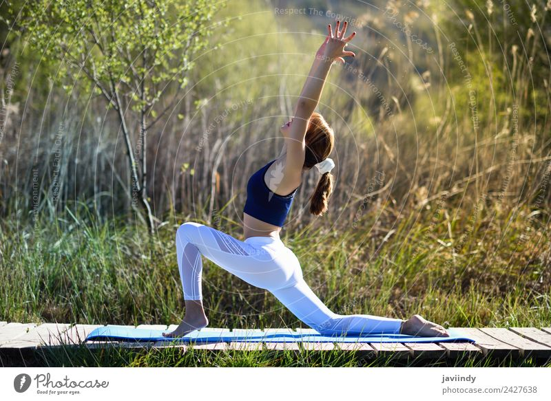 Young woman doing yoga in nature Lifestyle Happy Beautiful Body Relaxation Meditation Summer Sports Yoga Human being Youth (Young adults) Woman Adults 1
