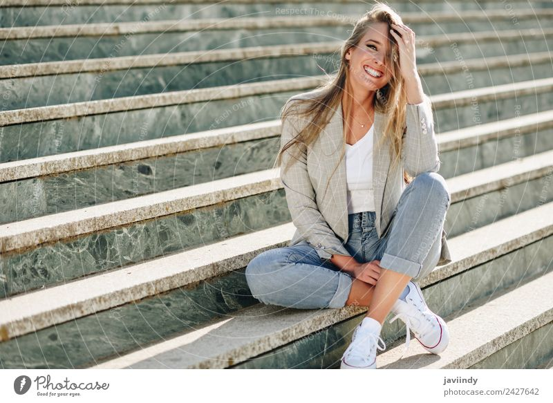 Blonde young caucasian woman smiling on steps Lifestyle Style Happy Beautiful Hair and hairstyles Human being Young woman Youth (Young adults) Woman Adults 1