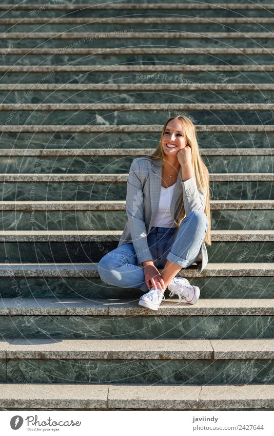 Blonde woman smiling in urban background Lifestyle Style Happy Beautiful Hair and hairstyles Human being Woman Adults Autumn Street Fashion Clothing Jeans