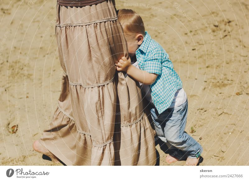 scared boy hiding in his mom's dress Human being Toddler Young woman Youth (Young adults) Mother Adults Family & Relations Infancy 2 3 - 8 years Child