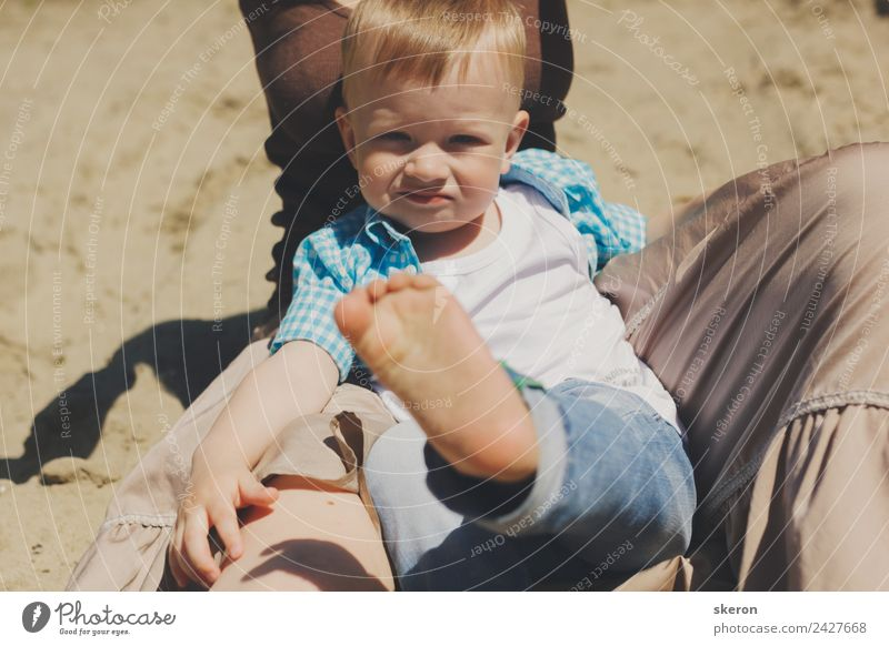 little boy sits on his mother's arms and shows his leg Child Human being Nature Vacation & Travel Youth (Young adults) Young woman Adults Legs Environment