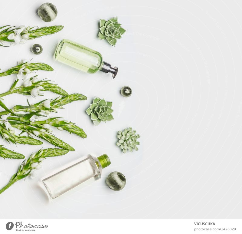 Green natural cosmetics in bottles Style Design Beautiful Personal hygiene Skin Cosmetics Healthy Wellness Spa Nature Plant Flower White Background picture