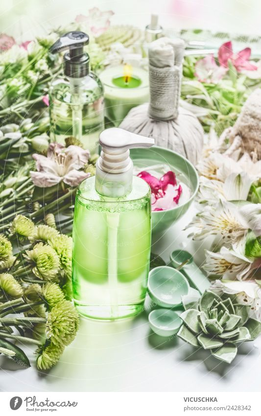Green cosmetics bottle with flowers and spa accessories Style Design Beautiful Personal hygiene Cosmetics Cream Healthy Health care Medical treatment Wellness