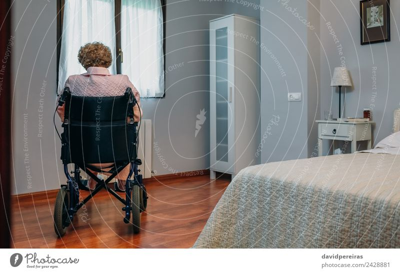Senior woman in wheelchair alone in room Lifestyle Health care Illness Medication Relaxation Hospital Retirement Human being Woman Adults Old Sit Sadness