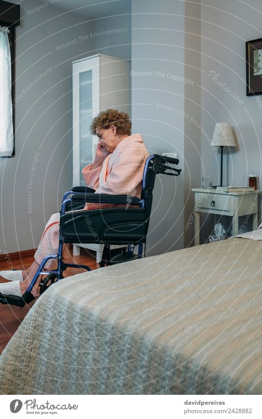 Senior woman in a wheelchair alone Woman Human being Old Relaxation Loneliness Adults Lifestyle Sadness Health care Lamp Sit Authentic Illness Medication Home