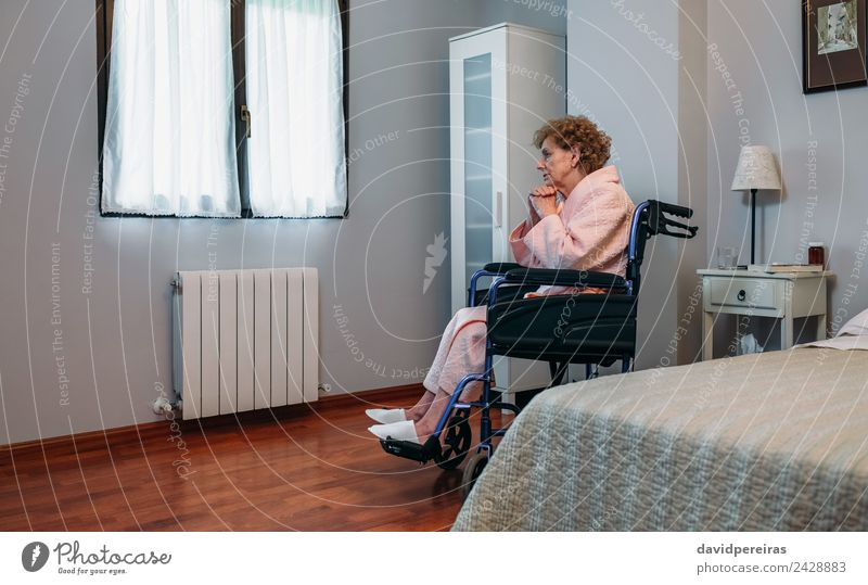 Senior woman in a wheelchair alone Lifestyle Health care Illness Medication Relaxation Hospital Human being Woman Adults Old Sit Sadness Authentic Hope