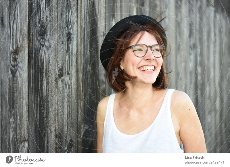 untroubled Feminine Young woman Youth (Young adults) 1 Human being 18 - 30 years Adults Wall (barrier) Wall (building) Eyeglasses Hat Brunette Short-haired Wood