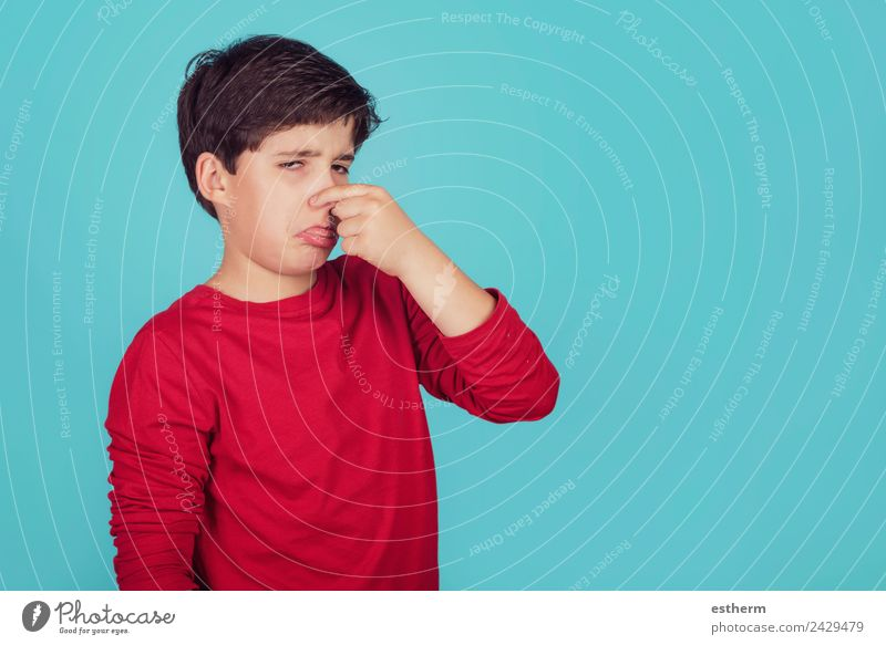 boy with hand in nose on blue background Lifestyle Personal hygiene Human being Masculine Child Toddler Boy (child) Infancy 1 8 - 13 years Breathe Fragrance