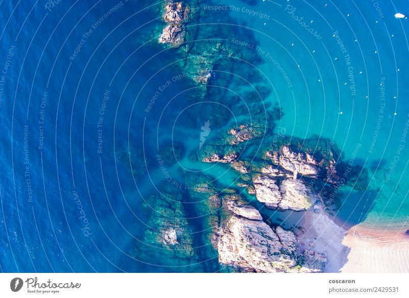 Aerial view of rocks in the coast of Costa Brava Beautiful Vacation & Travel Tourism Summer Beach Ocean Nature Landscape Sky Rock Coast Aircraft Blue background