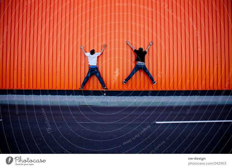 Human being Man Youth (Young adults) Joy House (Residential Structure) Adults Street Wall (building) Architecture Jump Building Wall (barrier) Friendship Funny
